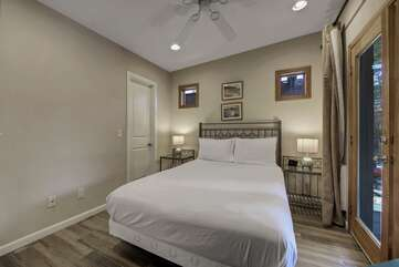 Suite 3 features a Full-sized bed, Smart TV and has exterior doors to the ping pong patio as well as access to the dinning room,