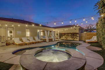 The large pool will keep you cool, the oversized spa is the perfect spot to unwind after a fun day.