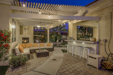 The perfect hang out spot is located near the pool. Room for the whole family on the comfortable patio couch and seating for four at the bar top.
