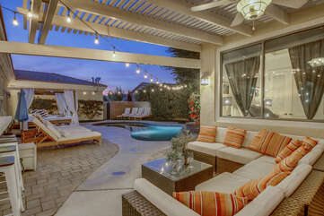 Lounge out on the comfortable and large patio couch.