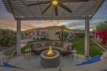 The brand new pergola will provide plenty of shade as you relax next to the natural fire pit.