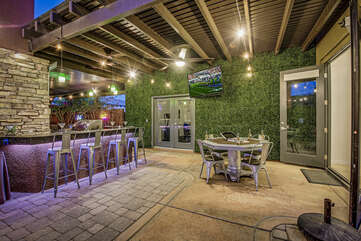 Hang out near the custom built in bar, watch a game on the outdoor TV or play a little game of poker, there is so much to do under the covered patio.