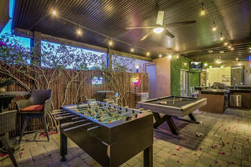 The game area is perfect for the kids and adults! Enjoy a game of Pool or table foosball or simply enjoy your beer on the bar height table with seating for two.