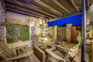Enter through the courtyard where you will find a quiet spot to hang out with seating for four and quaint waterfall table.