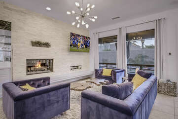 Enjoy the game on the big screen HDTV with Roku while staying warm next to the gas fireplace.