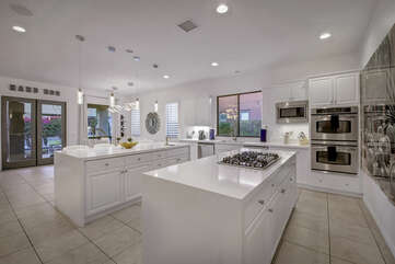 You will love to prepare all your meals and snacks in this fabulous kitchen, fully equipped with a 5- burner gas cooktop, double oven and GE Profile Triton dishwasher.