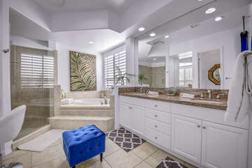 Large private bath has a dual sink vanity, oversized custom tiled shower, soaking tub and Makeup counter.