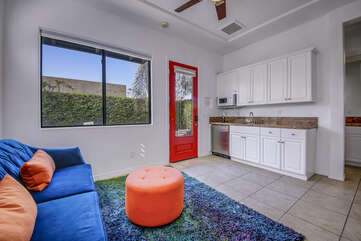 The casita kitchen area has an under-counter refrigerator including a high-capacity ice maker, microwave oven, sink and beautiful slab granite counters.