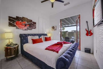 Bedroom 5 has a King-sized bed, separate entry from the landscaped courtyard, & TV.