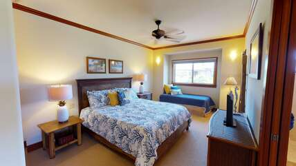 Bedroom with Two Beds, TV, Dresser, and Ceiling Fan