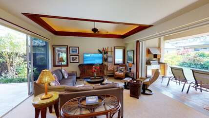 Living Area with Sofas, Accent Chairs, Ceiling Fan, and Smart TV