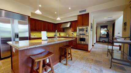 Kitchen with Island, Refrigerator, and Oven