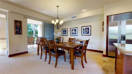 Dining Area with Lanai Access, Dining Table, and Refrigerator
