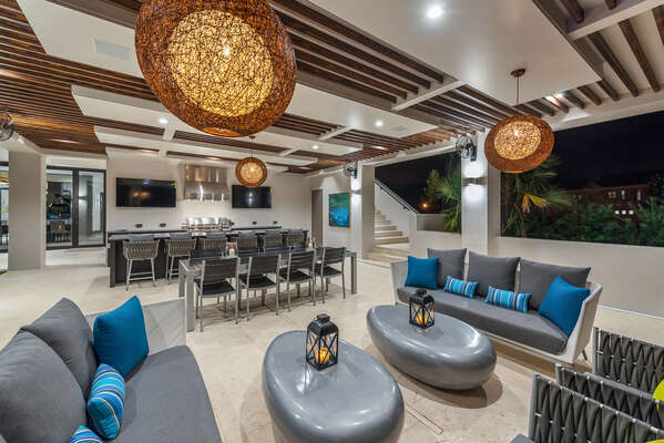 Relax and unwind in style on this beautiful outdoor patio, complete with a summer kitchen