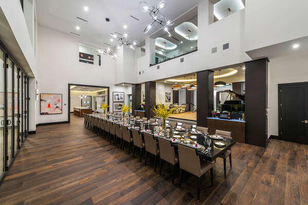 A custom Italian black marble dining table has seating for more than 40 guests
