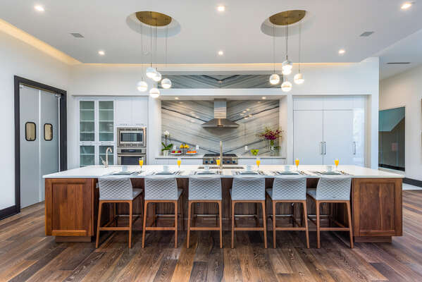 A fully equipped gourmet kitchen also offers 9 bar seats