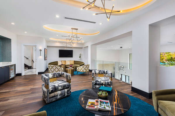 Never miss a game in this modern sports lounge with multiple TVs and comfortable seating