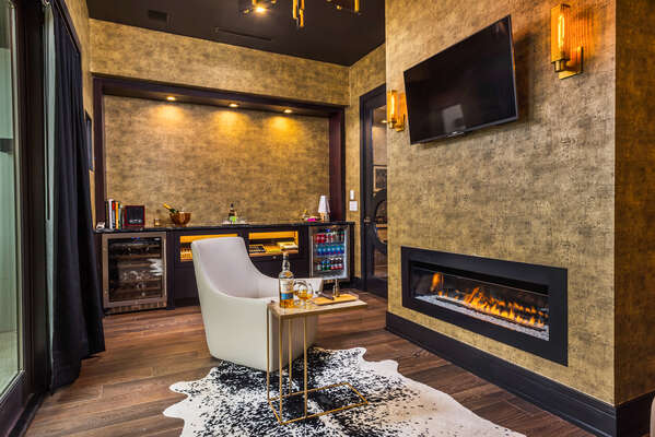 The executive lounge, detailed with black onyx marble, wood and leather accents creates a relaxing atmosphere (Disclaimer: Fireplace(s) not allowed for guest use, homeowner use only.)