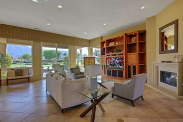 Huge open floor plan with large windows to keep an eye on the pool from the living room
