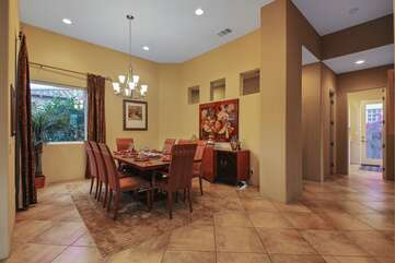 Formal dining room has high end furnishings