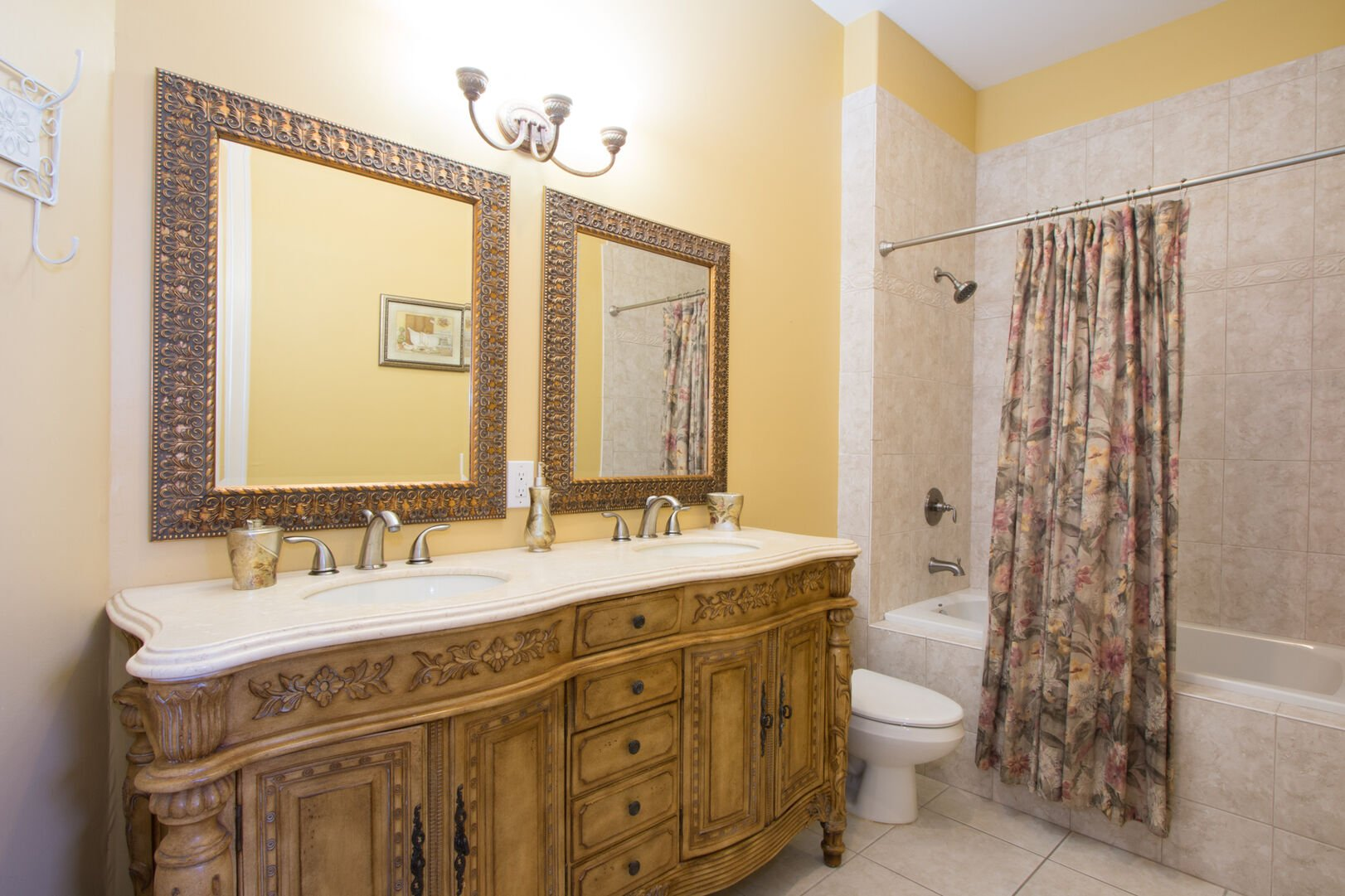 Bathroom with shower/tub combo in our vacation home in Fort Myers Beach