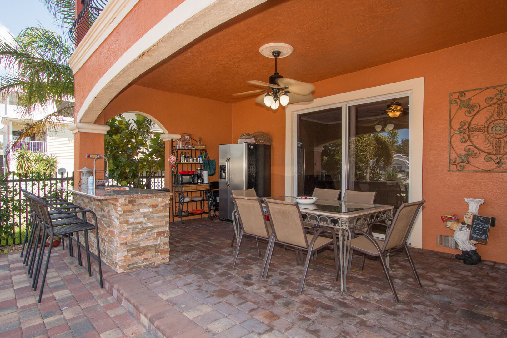 Patio with seating and wet bar in our vacation home in Fort Myers Beach