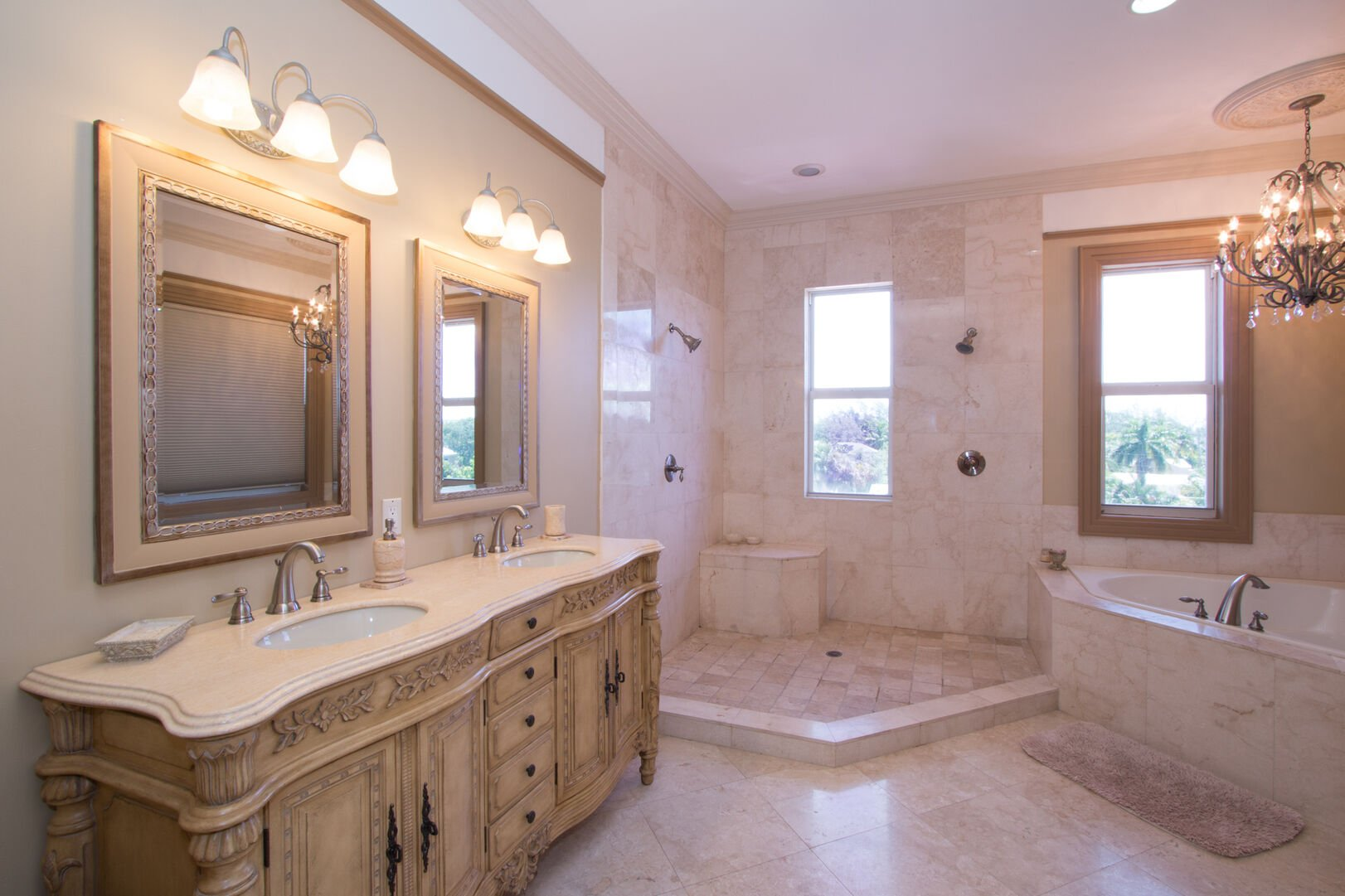 Bathroom with tub and shower in our vacation home in Fort Myers Beach