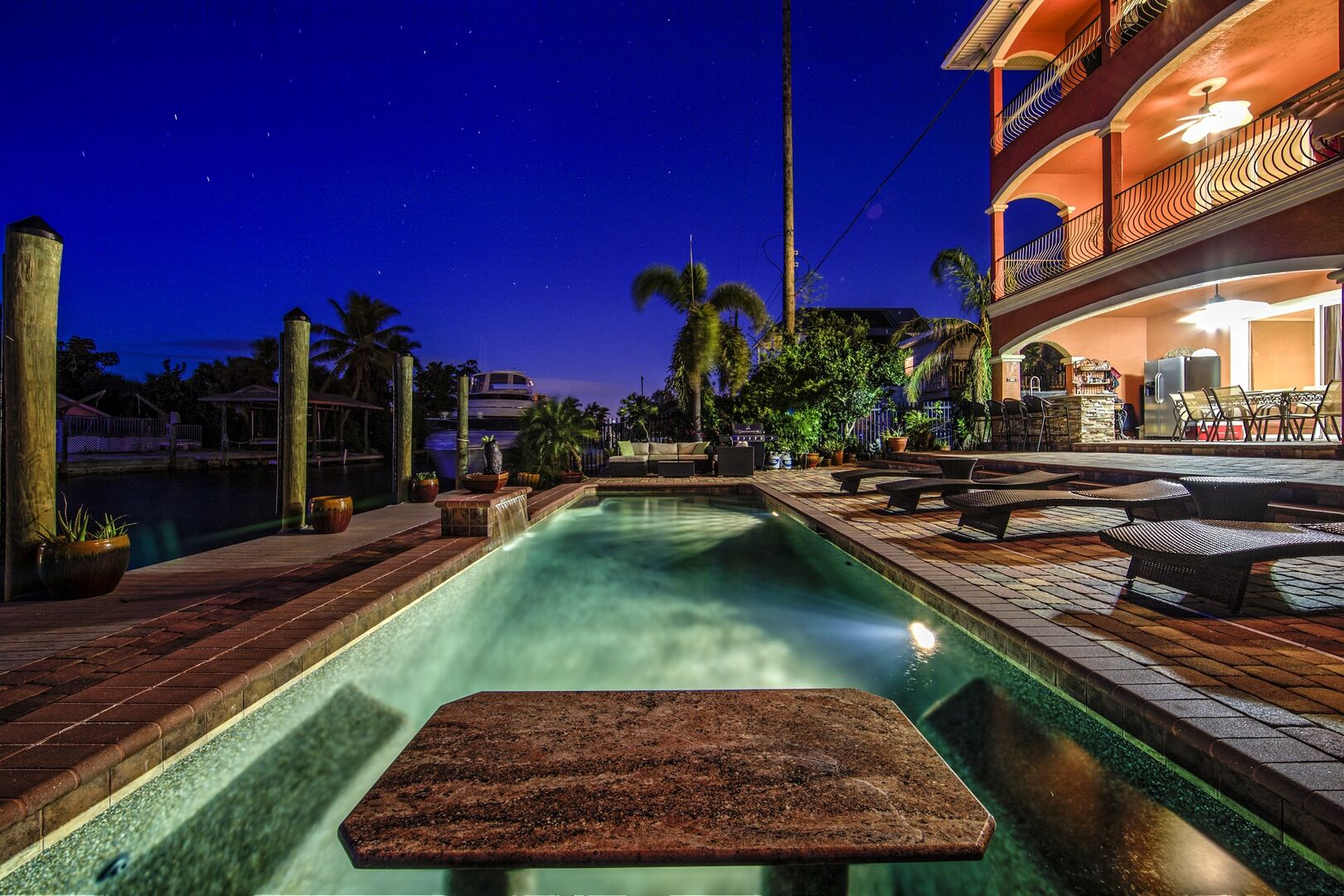 Pool with seating in our vacation home in Fort Myers Beach