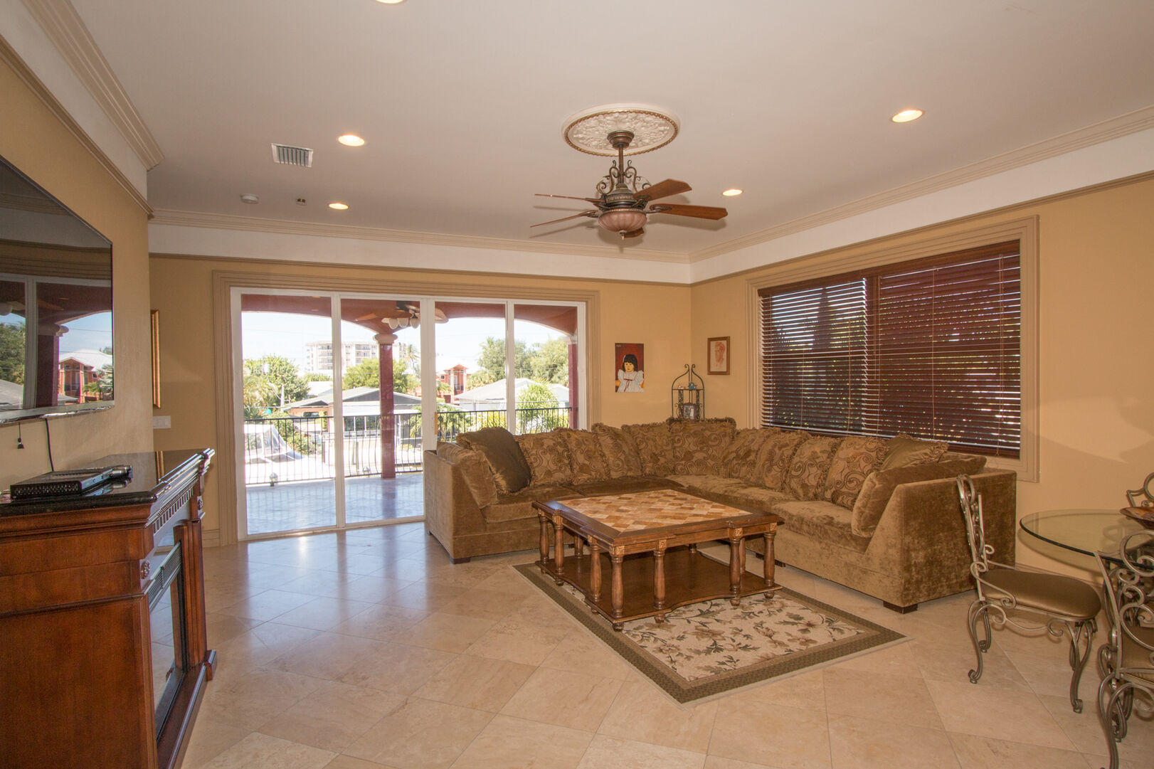 Living area with couch and patio access in our vacation home in Fort Myers Beach