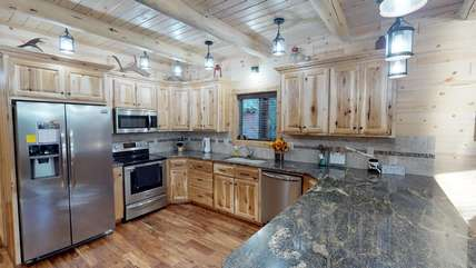 This gorgeous kitchen includes everything you need to cook as well as beautiful granite countertops and stainless steel appliances.