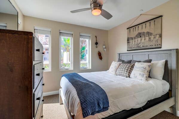 Guest Bedroom Includes Wooden Dresser.