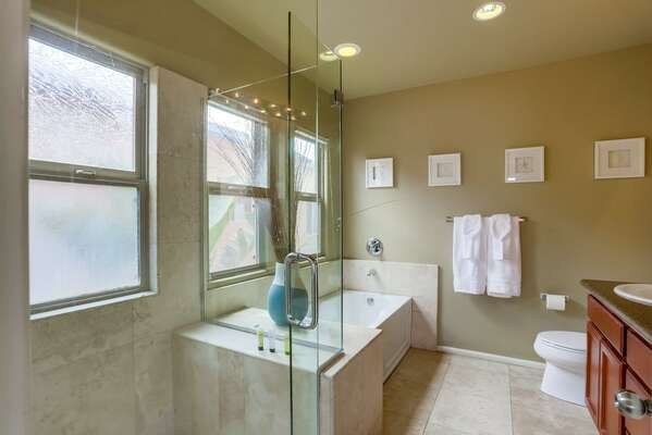 Large Soaking Tub and Separate Shower of bathroom.