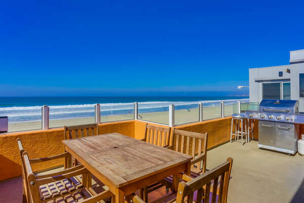 Large Ocean Front Deck of this Mission Beach vacation rentals beachfront with BBQ