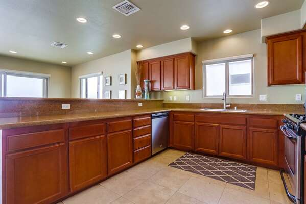 Fully Stocked Kitchen with wood cabinets and modern appliances.
