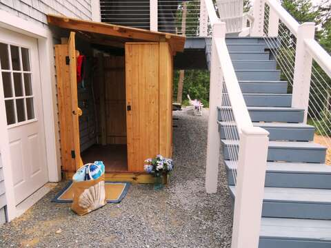 Stairs from the deck lead to the outdoor shower and path to the pond! - 162 Owl Pond Brewster Cape Cod - New England Vacation Rentals