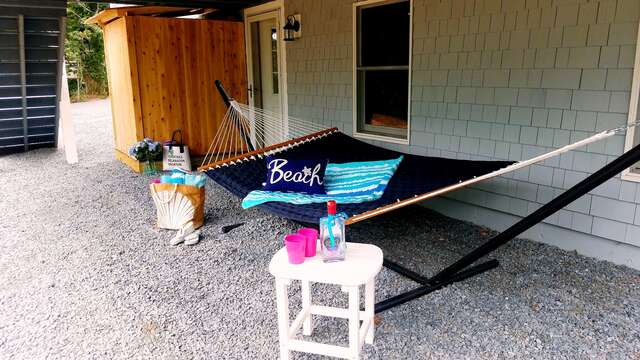 Hammock under deck with an outdoor shower too! - 162 Owl Pond Brewster Cape Cod - New England Vacation Rentals