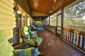 The back screened porch has seating for the whole family.