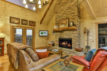The rich wood from floor to ceiling and a stone fireplace with gas logs is waiting your stay at Eagles Breeze.