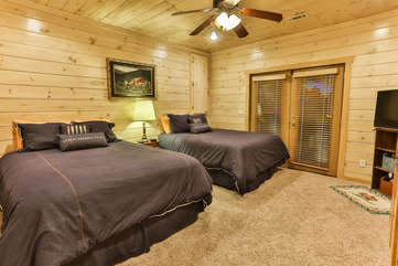 The lower level bedroom has two Queen beds located off the family game room.