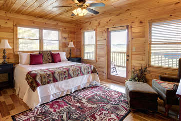 The main level bedroom offers a King Bed with adjoining Bathroom and assess to the Main Deck. 32