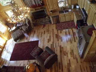This View is from the loft area showing the great room. Enjoy family time around the warmth of a gas log fireplace