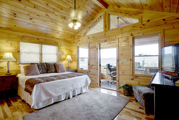 The Master Bedroom is located on the Upper Level of this tastefully decorated home. This bedroom offers you a spectacular reading area with a wall of windows that provides long range mountain views for you to wake up to everyday.