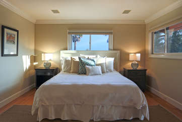 The third guest bedroom affords green views from every window