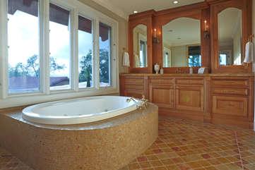 Bathe in style in the soaking tub or walk-in rain shower of the main bedroom's en suite bath
