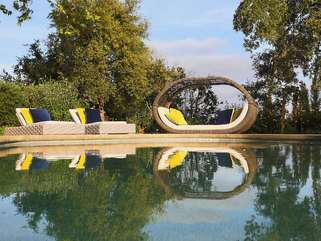 Lounge in the warm sun, cool off in the sparking pool, forget what time it is, and surrender to the moment