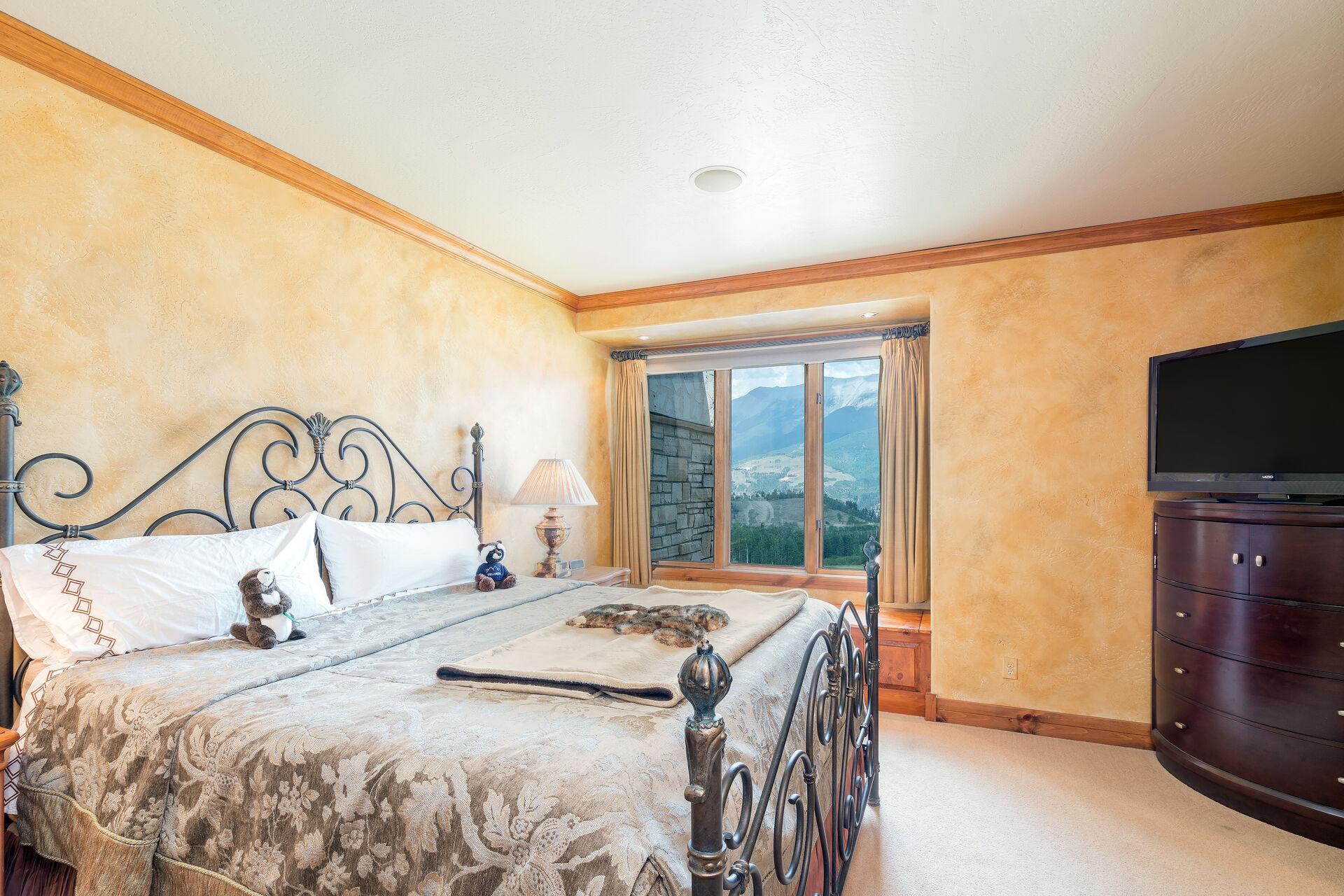 Bedroom with dresser top tv
