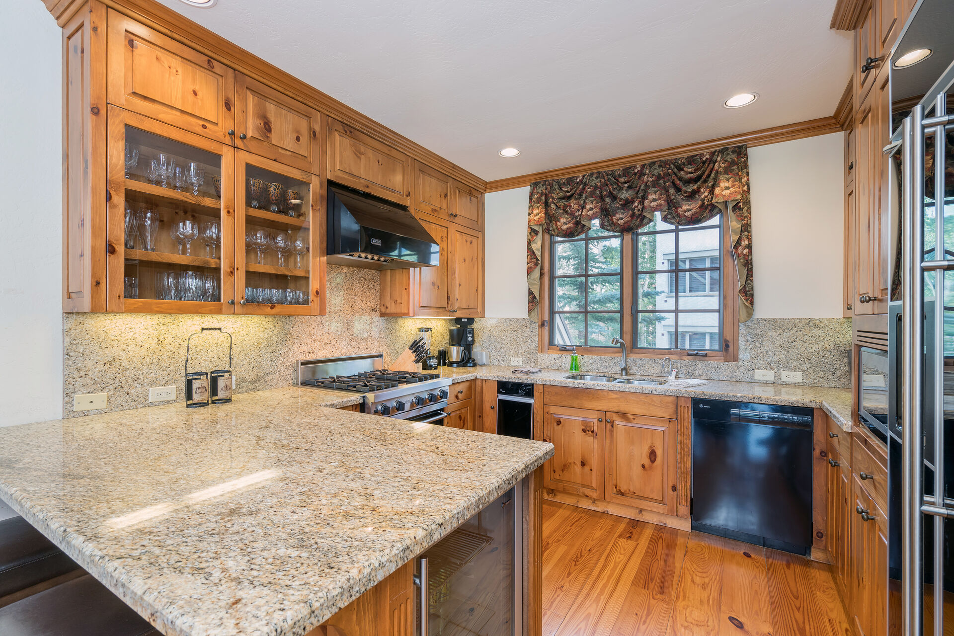 Kitchen area with wraparound counters and an oven.