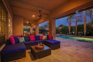 Outdoor couch seating area to watch TV poolside