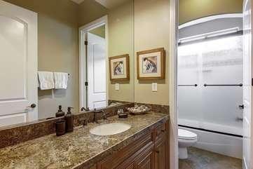 The Casita en-suite bathroom features a tiled shower, plus a starter set of L'Occitane soaps.