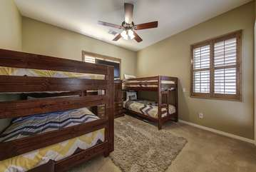 Bedroom 4 has full size bunk beds that sleep 4 and twin size bunk beds that sleep 2 for a total of 6